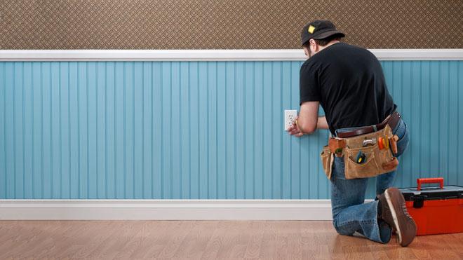 man installing electrical socket
